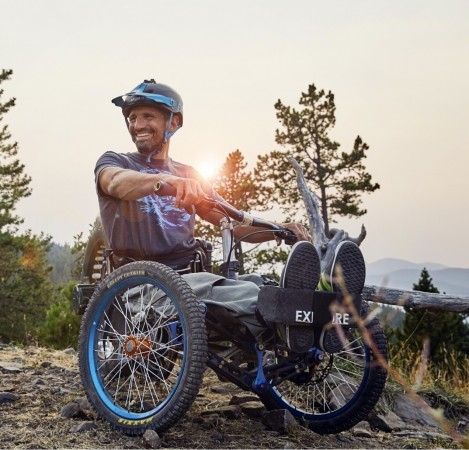Christian Bagg on a battery powered Icon Explore on a backcountry trail.