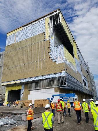 A view of the exterior Ingenium Centre that faces St. Laurent Blvd. The large gap near the top of the building will be a decorative display case.