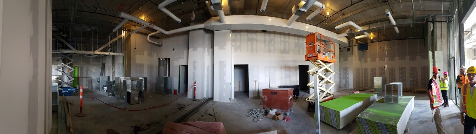 A panoramic view of staff meeting rooms and office space.