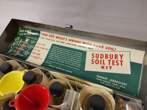 A colourful, family history shines behind a soil test kit