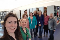 "Ingenium staff take a group ""shelfie"" in the new Ingenium Centre Library and Archives."