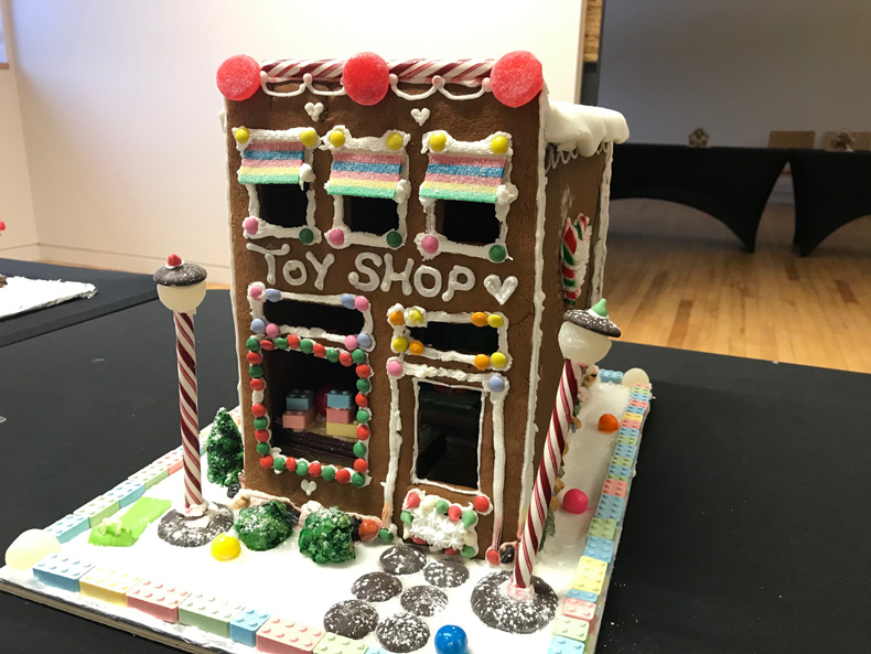 Gingerbread house made to look like a toy shop