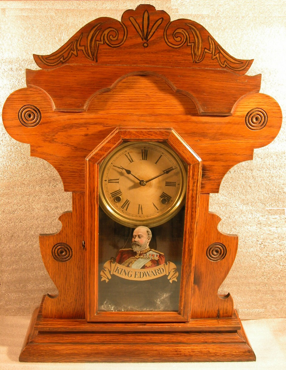 A clock made by the Arthur Pequegnat Clock Company, ca 1904, decorated with a transfer image of King Edward VII
