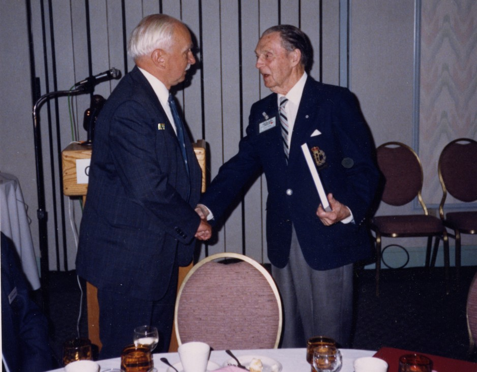 The National Aviation Museum's founding curator, K.M. Molson, (left) shakes hands with Punch Dickins, a pioneering Canadian aviator at the International Association of Transport Museums Conference, held September 26-30, 1988.