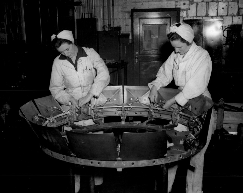 Trans-Canada Air Lines photographs - Female workers assembling cowl flaps in the Trans-Canada shops at Winnipeg.