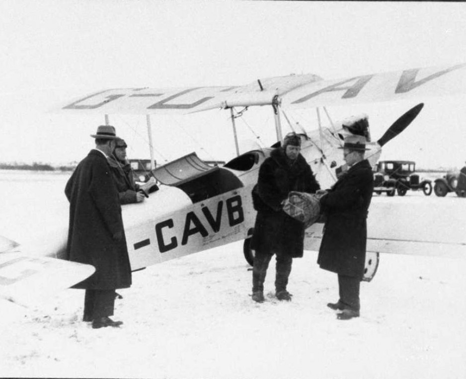 Vic Horner being handed a bundle of Diphtheria antitoxin at the start he and May's journey from Edmonton to Fort Vermillion
