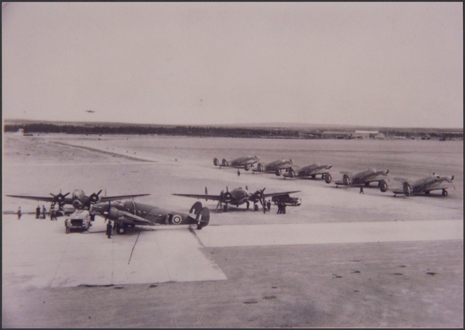 Eight Hudson Bombers on the tarmac at Gander Airport preparing for departure to England.