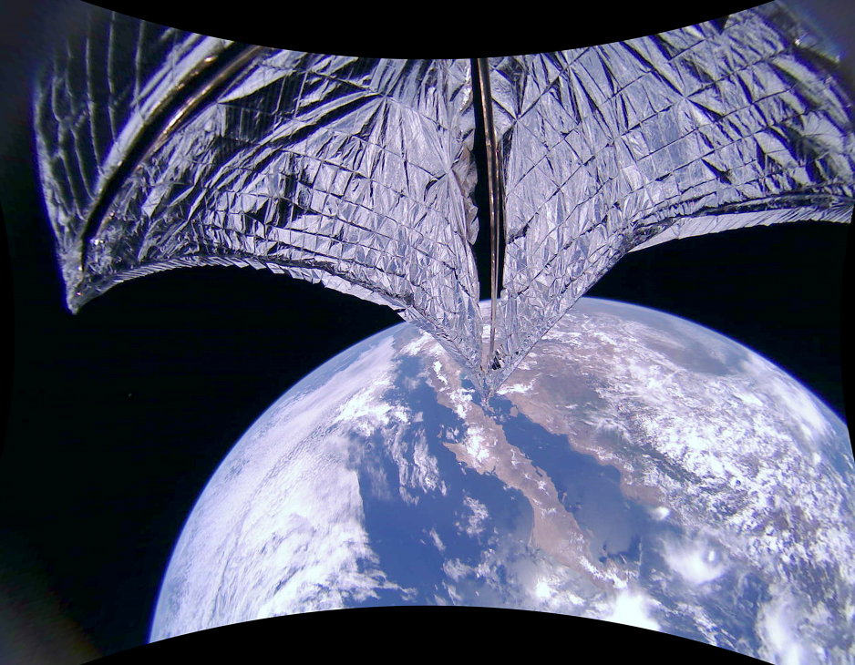 The silver-coloured solar sail of LightSail2 extended fully, with Earth below. Baja California and Mexico are visible.