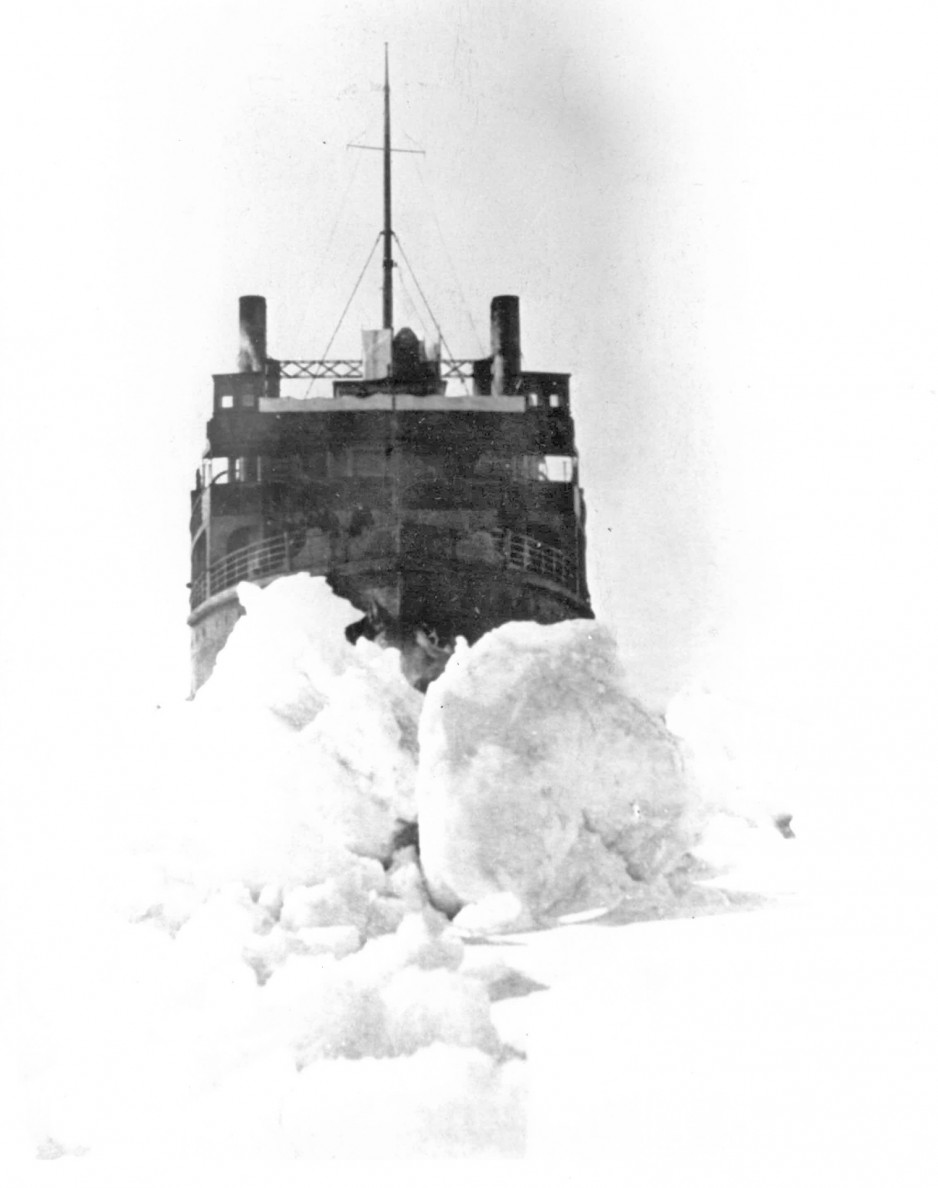 A black-and-white image of the SS Prince Edward Island breaking through heavy ice.