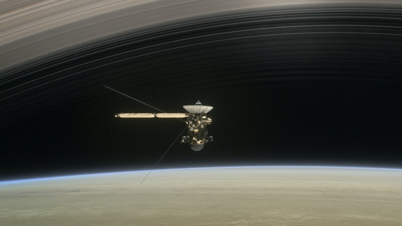 An artists impression of the Cassini spacecraft above Saturn