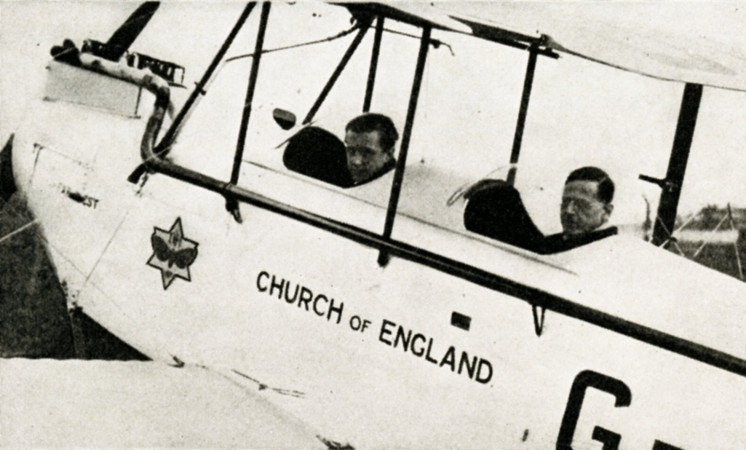 "Reverend Leonard Daniels, in the front seat of the de Havilland Moth he flew in Australia. Anon. ""The Church of England Takes to the Air!"" Air Travel News, January-February 1928, 20."