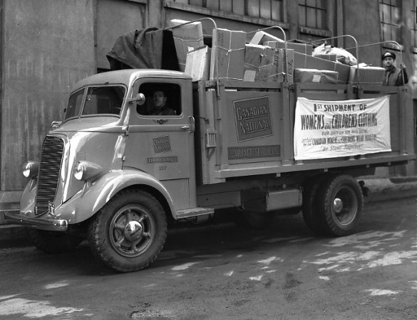 Canadian National cartage truck transporting women's and children's clothing for shipment oversees, in 1940.