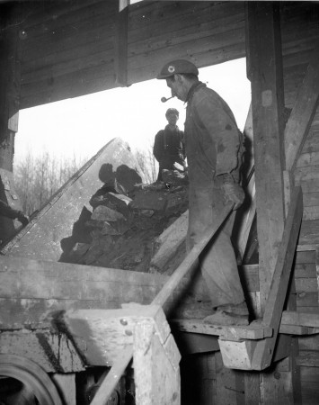 Iron ore being dumped into the crusher at an emergency war mining project in Eastern Canada.