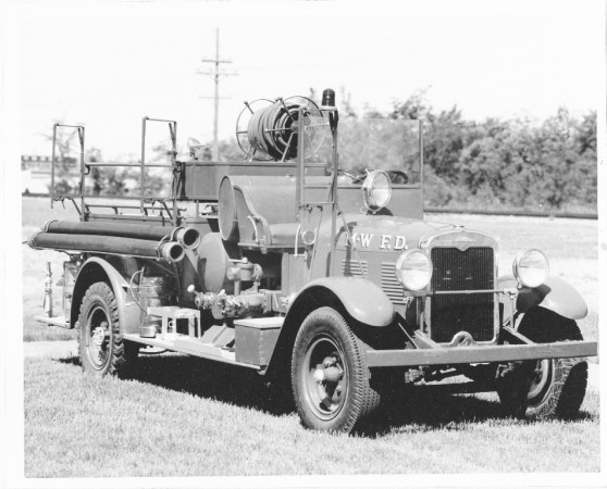 Black and white photograph showing an old fire truck CR K84-135.