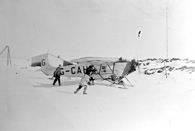 Black and white photograph of airplane G-CAHF taxying down the slipway