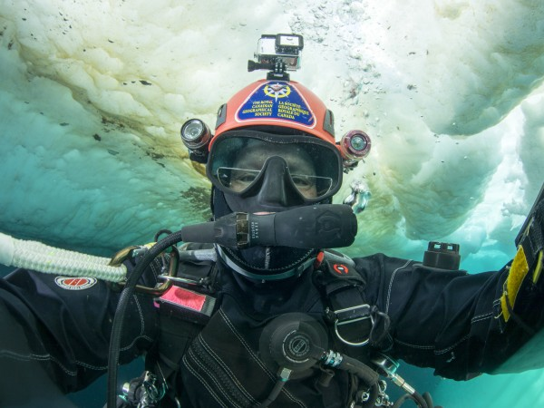 Heinerth photographs the under surface of the sea ice near Bylot Island. Photo credit: Jill Heinerth