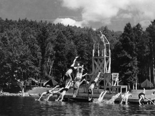 Children diving into the lake at Arowhon Camp