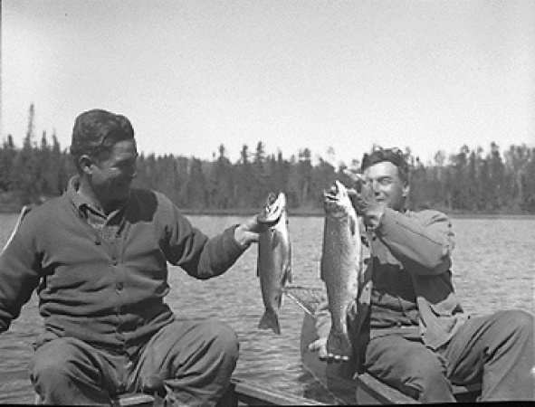Two guides holding the fish they caught in Bird Lake