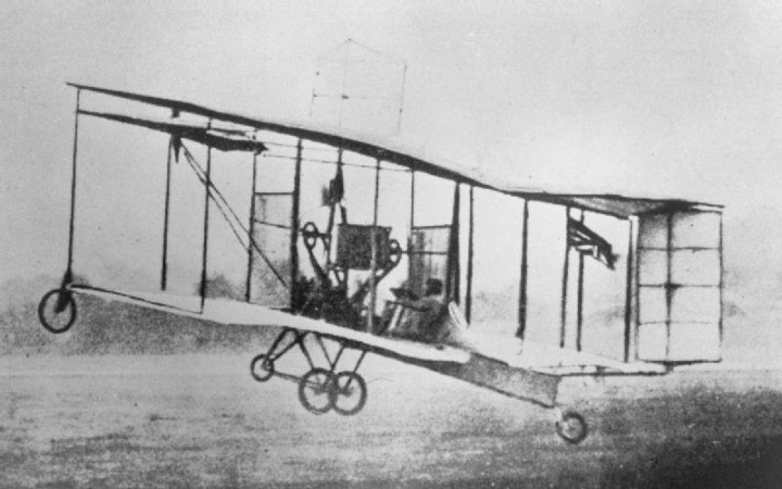The British Army Aeroplane No. 1 in flight, Farnborough, England, October 1908. Its designer, Samuel Franklin Cody, was at the controls. Imperial War Museum, negative number RAE-O 995.