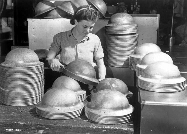 Female worker making steel soldiers' helmets at General Steel Wares