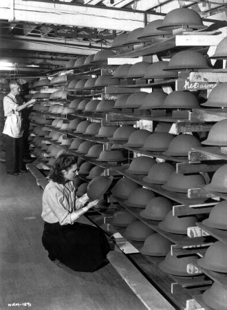 Shelves filled with soldiers' steel helmets at General Steel Wares,