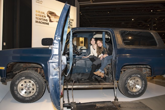 Elaine's daughters, Jamie Wolfe Phillips and Emily Wolfe Phillips, get a chance to sit in their childhood vehicle, which is now part of the Moving Stories exhibition.