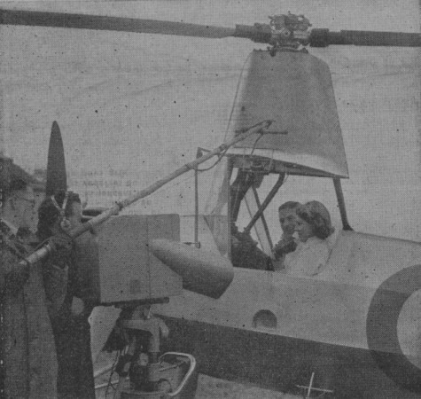 "Jasmine Lydia Bligh, television hostess at the British Broadcasting Corporation, aboard a Cierva Rota autogiro of the Royal Air Force with Reginald Alfred Charles Brie, Hanworth, England. Anon., ""On a 'télévisé' les évolutions d'un autogyre."" Paris-Soir, 21 February 1939, 10."