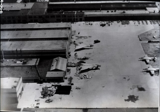 A black-and-white image showing the last two Arrows in the process of being destroyed.