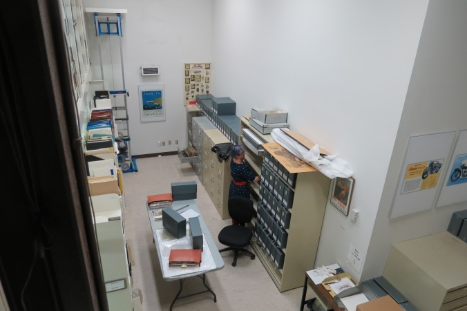 Student working in trade literature room, photograph shot from above.