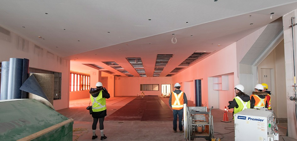 Staff take a look at the new library space, which will be open to the public. (February 2019)