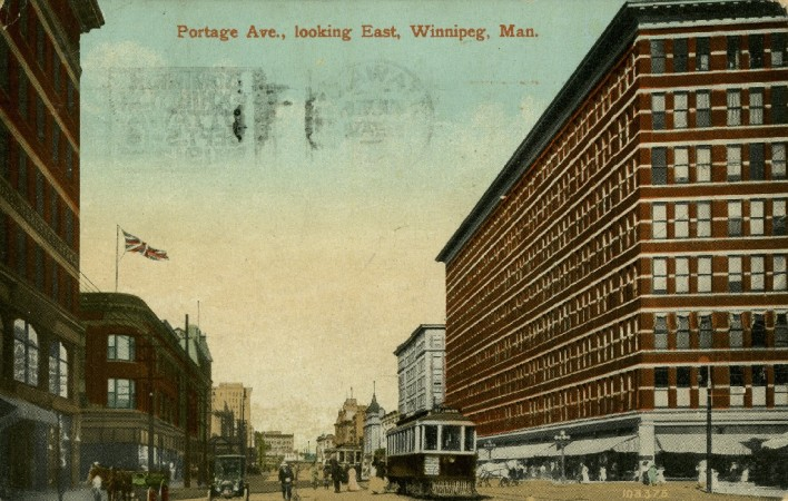 Colour post card showing streetcar on Portage Avenue in Winnipeg