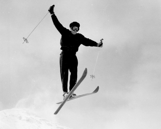 Skiier in the air after a jump