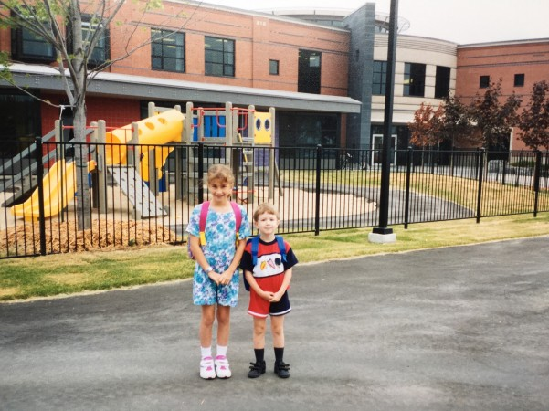 Kindergartener Nathaniel Whelan and his older sister standing outside Roberta Bondar Public School.