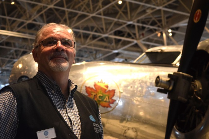 Robert Day stands by the Lockheed 10E Electra, made famous by Amelia Earhart's attempted trip around the world.