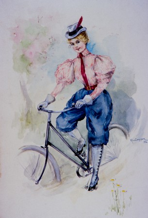 Woman wearing pants, riding safety bicycle