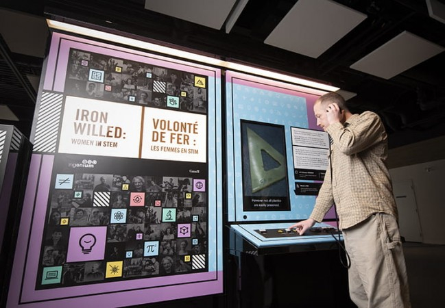 Photo of someone using an interactive in the exhibition Iron Willed: Women in STEM