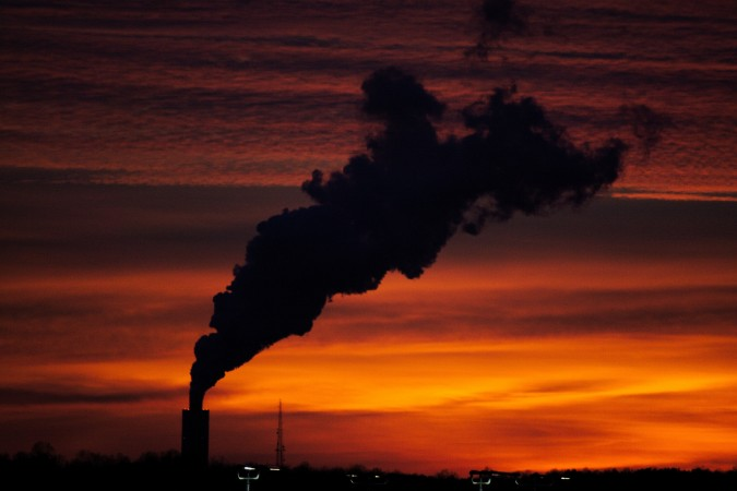 The smog from industry creates a silouette against a sunset.