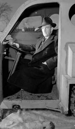 Armand Bombardier, seated at the wheel of the Bombardier military snowmobile in 1943. Credit: Library and Archives Canada reference number WRM 276.