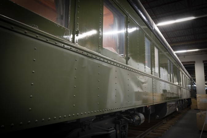 A side view of a Governor General's rail car, with a glossy forest green exterior.