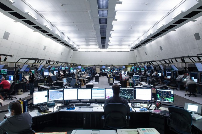 NAV CANADA employees work on computers at an area control centre in Winnipeg
