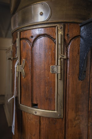 A close-up view of the wooden and brass door of the binnacle.