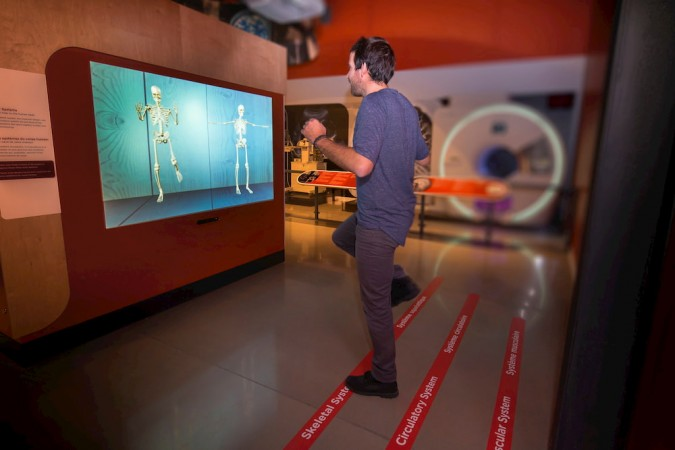 Person interacting in the Medical Sensations exhibition