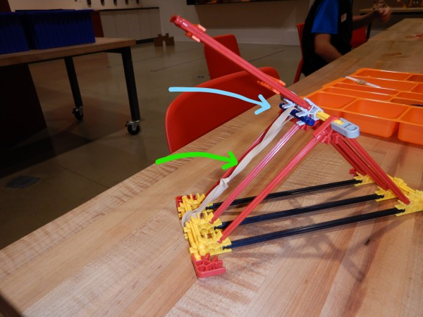 "A nearly complete catapult made from K'NEX. Missing is the ""cup"" where the projectile will sit."