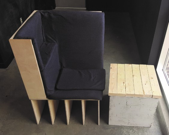 A model of a modern-looking chair and side table
