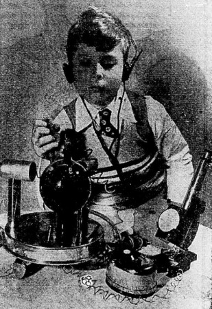 "A boy and elements of a toy on display at the 1950 edition of the toy fair of New York City, New York: Stefan Olsen and the cloud chamber of a Gilbert Atomic Energy Lab. Anon., ""La page des enfants – Initiation atomique."" Photo-Journal, 13 April 1950, 20."