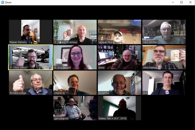 A computer screen shows 14 people taking part in a video coffee chat over Zoom.