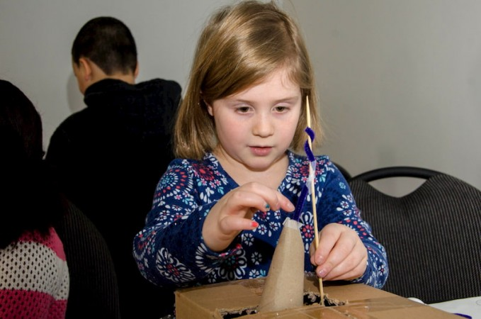 Young girl building a structure in Exploratek