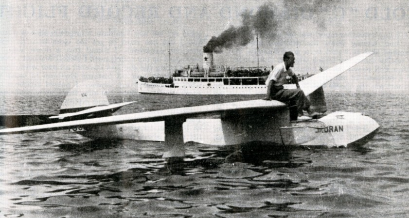 "A Koser / Koser-Hrovat KB-3 Jadran hydroglider, Adriatic Sea, summer 1949. In the background, the coastal passenger ship Dalmacija of the government-owned shipping firm Jadranska Linijska Providba. Anon., ""Gliding and sailplanes in Yugoslavia."" Sailplane and Glider, June 1950, 125."