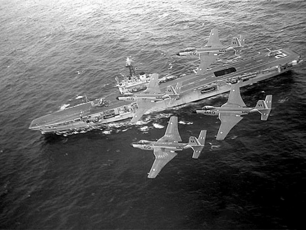 McDonnell F2H-3 Banshees of the Royal Canadian Navy fly over the HMCS Bonaventure