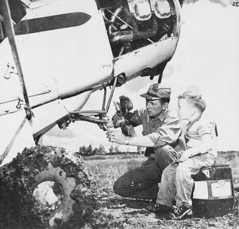 "Eldon Douglas McEarchern working on his agricultural Piper PA-18 Super Cub as one of his sons watched on, Carman, Manitoba. Anon., ""Les fermiers volants de l'ouest canadien."" Le Samedi, 22 October 1960, 25."